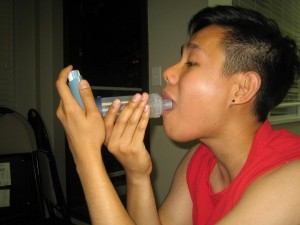 Using an asthma inhaler with a spacer