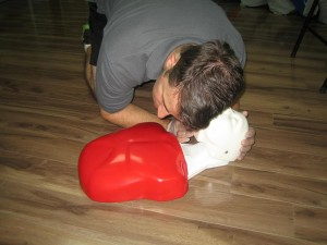 Checking for breathing of an unconscious victim